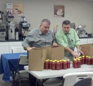 Keith and Blaine labeling their sauces for distribution.